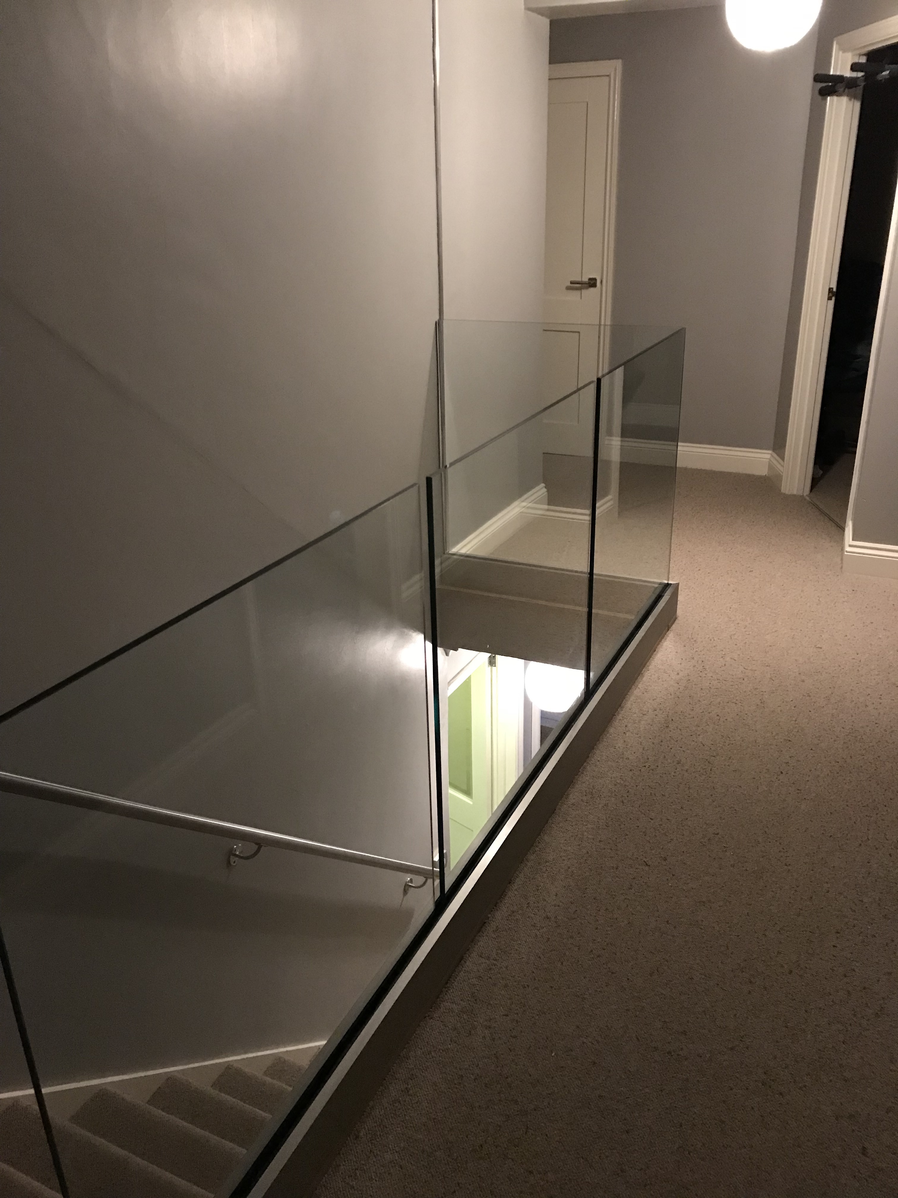 Infinity glass balustrade installed in this landing area in London