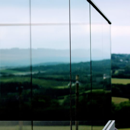 aluminox cornwall view from the side of frameless glass balustrade