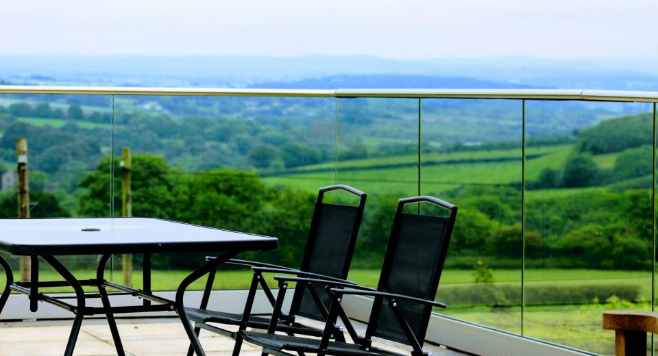 Aluminox Solus frameless glass balustrade channel installed on a patio in Cornwall