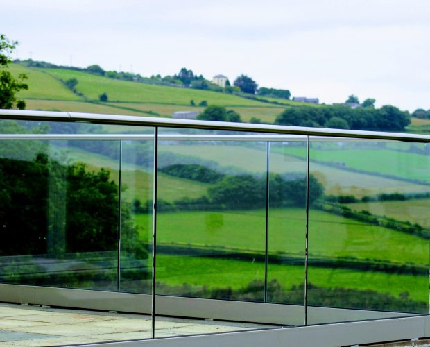 Aluminox Frameless glass balustrade around a patio area in Cornwall