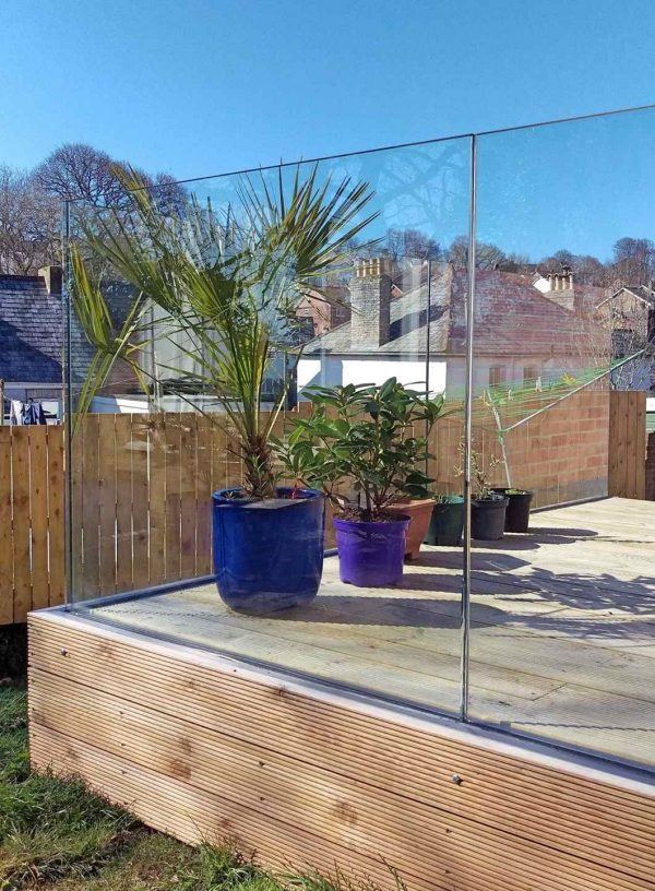 aluminox glass balustrade fitted to a wood decking in Cornwall