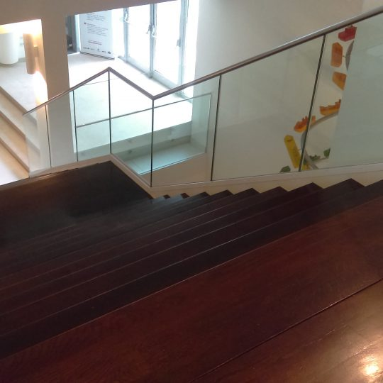 glass balustrade going down a staircase aluminox