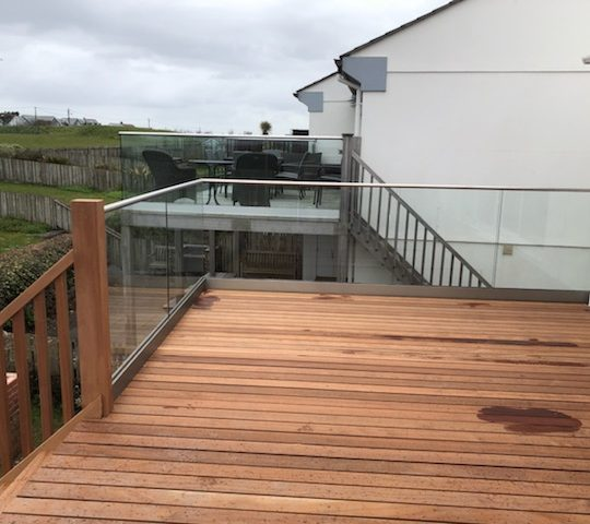 glass balustrade installed on a wooden decking