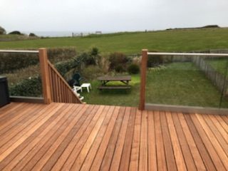 glass balustrade on a wooden deck in rock cornwall