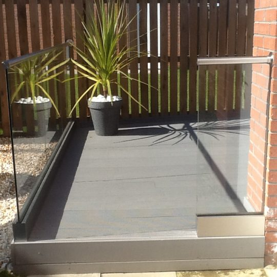 aluminox Glass balustrade on a composite decking