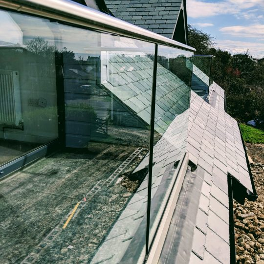 glass balustrade installed on a dorma opening in cornwall by aluminox