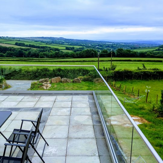 Glass balustrade installed on a patio in Cornwall