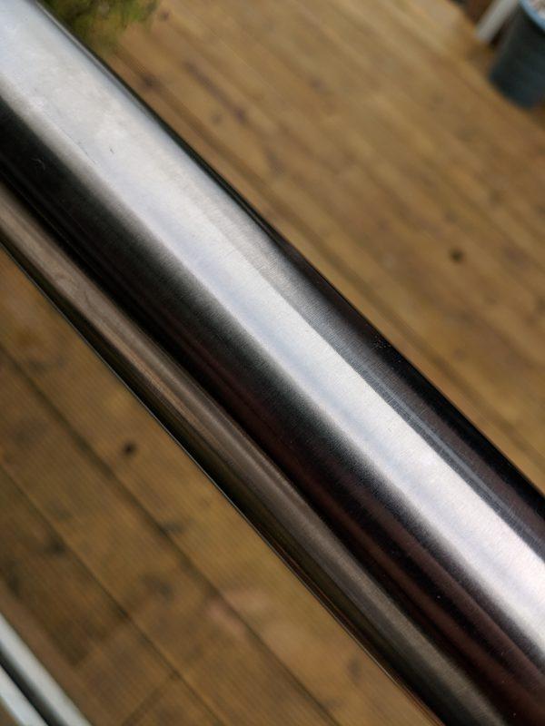 Glass balustrade slotted handrail aluminox