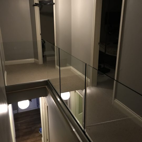 our Solus system on landing area glass balustrade