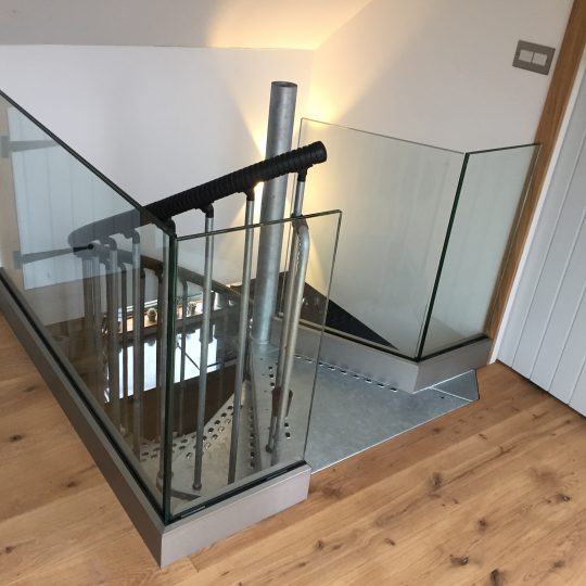 scotland frameless glass balustrade around an opening around the landing