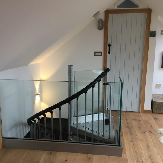 Glass balustrade around a landing area in scotland