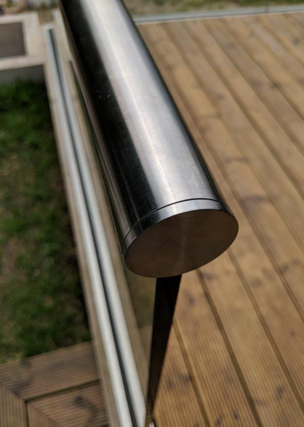 aluminox handrail end cap on frameless glass balustrade on decking