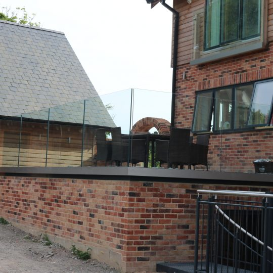 Balustrades Solus system installed on a patio for frameless glass balcony